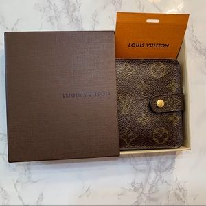 Louis Vuitton bifold wallet with coin pocket.
